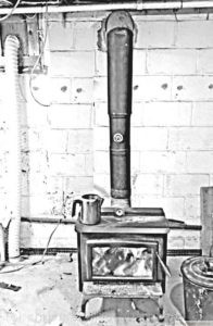 Stove and snorkel for starting a below grade woodstove