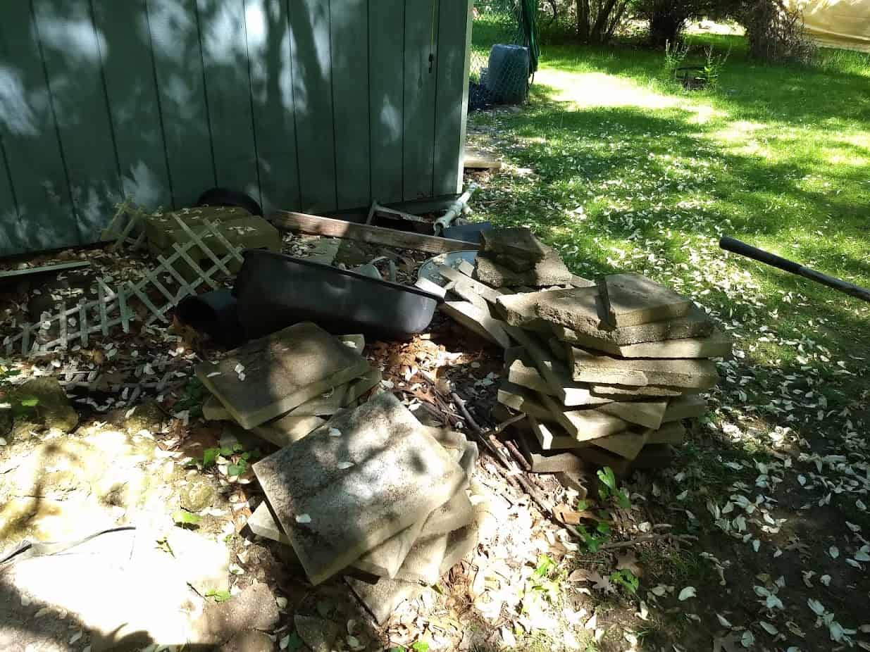 Pile of surplus pavers and cinder blocks cluttering up my yard.
