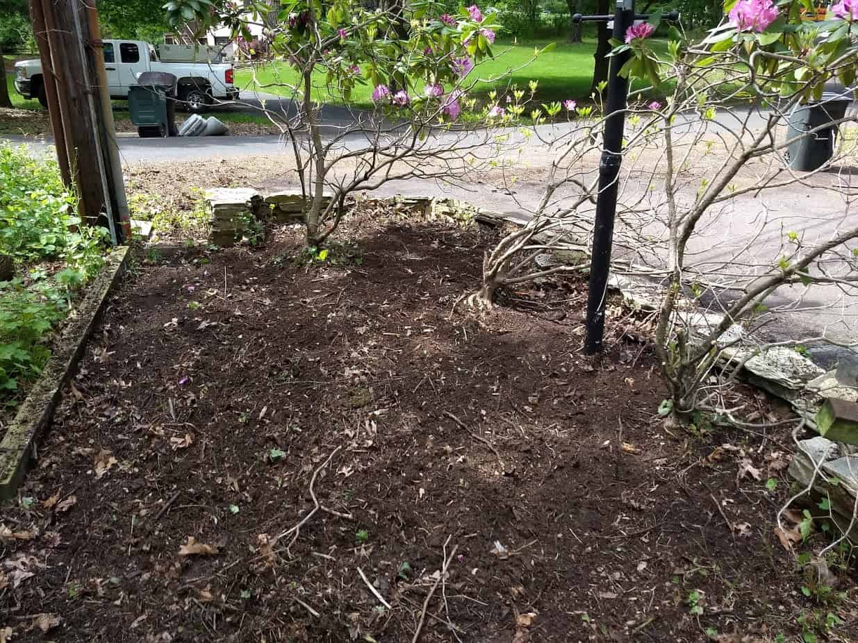 Flower bed after cultivating with 4x4' for the wall base.
