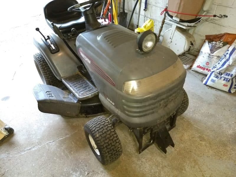 A Sears Crafstman LT-1000 lawn tractor with a blown head gasket.