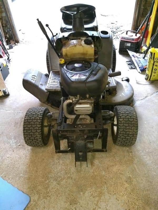 Sears Craftsman LT 1000 lawn tractor with a blown head gasket.