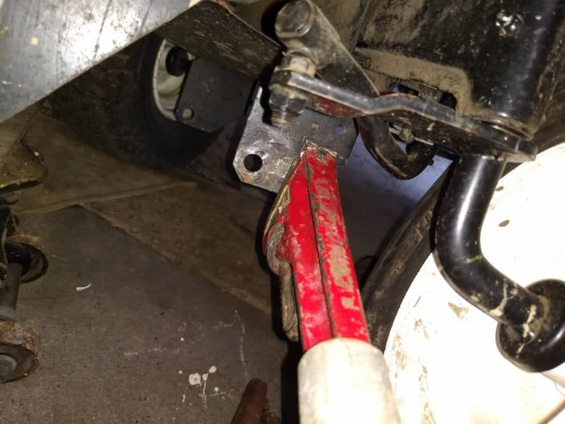 Fit a pipe to the pipe wrench handle for additional torque.