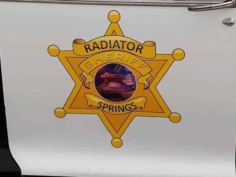 Radiator Springs Sheriff Emblem on a 1940 Chevy Cop Car.