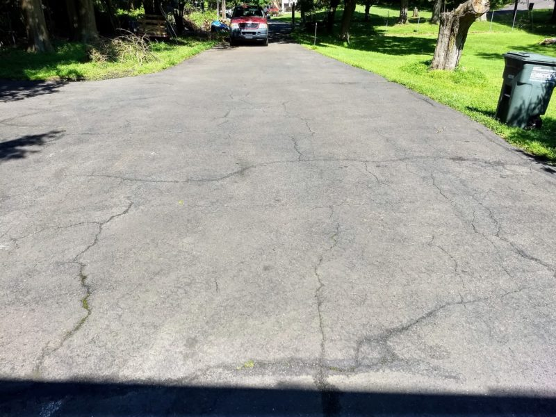 Deteriorated asphalt drivewauy