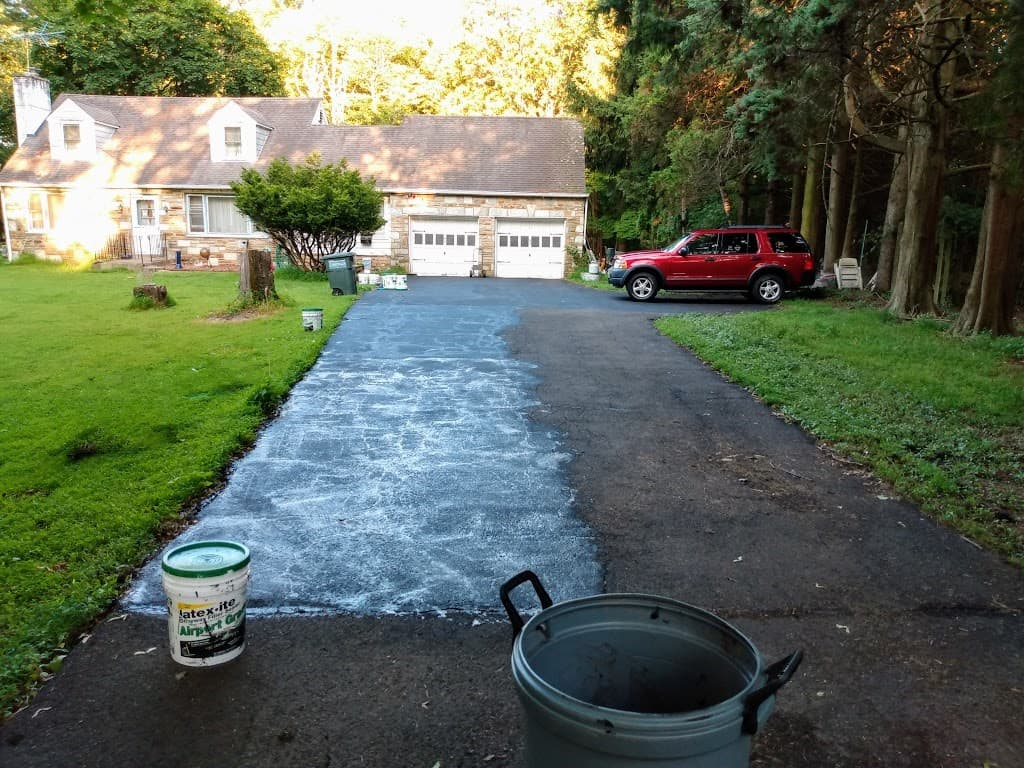 Section of newly sealed asphalt driveway