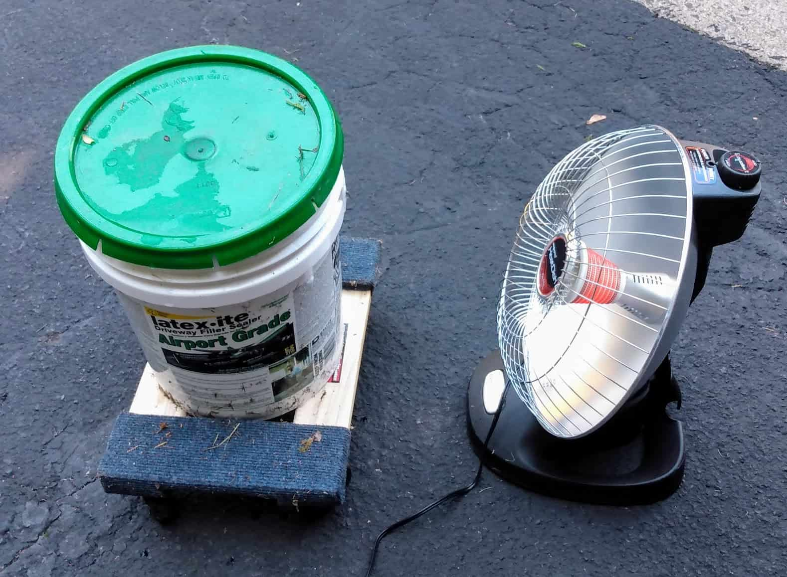 Heating driveway sealer with an infrared heater.