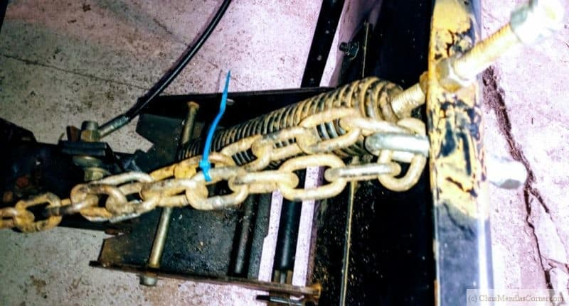 Using a chain to raise the clearance of a snow plow