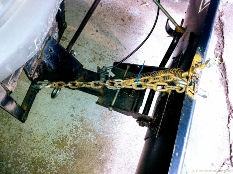 Chain setup for raising the tractor blade.